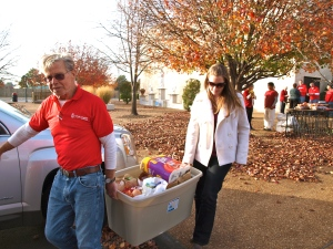 John McNary and I carry food for one of the families at the Mobile Food Pantry
