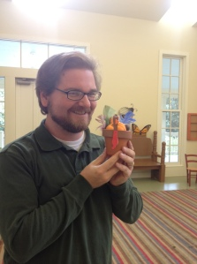Drew Massengale models his turkey Sue during the Caterpillar Club at the Memphis Botanic Gardens