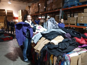 Teens sorting coats at Boise Rescue Mission