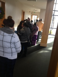 Families in line at the St. James' Food Pantry