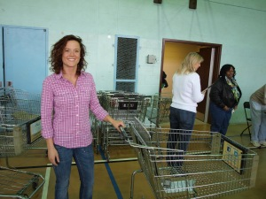 Rebekah readies her shopping cart to help families in the Santa Shop