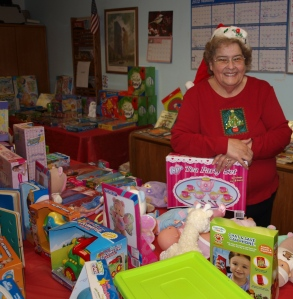Ruthie beams amid the toys at the Santa Shop