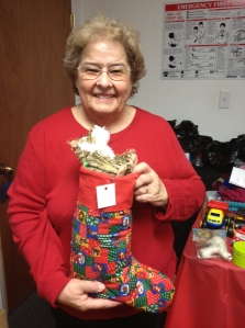 Ruthie Robertson proudly displays one of her homemade Christmas stockings