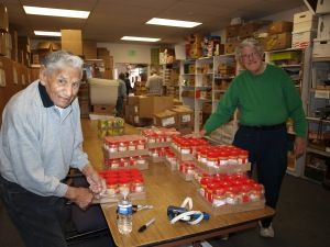 Dedicated volunteers (including their volunteer of the year) unload and sort canned goods