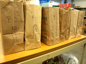 We drew pictures to keep the bags pairs together. Rebekah drew two volunteers on the left set of bags.
