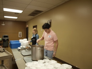 Volunteers Lauren Rhodes and Mark Kimura serve lunch